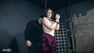 Redhead in white stockings Kel Bowie spanked and abused in chains