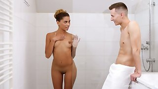 Tanned GF with natural tits Baby Nicols gives stud a blowjob in the shower